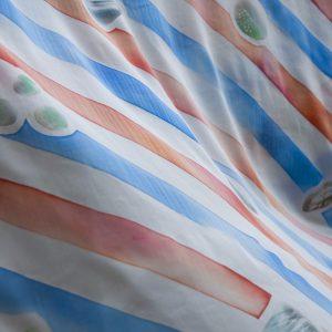 ろうけつ染めの布、柄モチーフはパーマ屋さんの話。multi cloth(perm stone)/ cotton100%(satin)