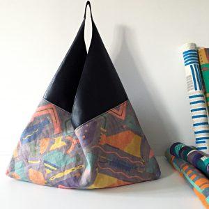 革素材と組み合わせて大人っぽい雰囲気に仕立てた吾妻袋です